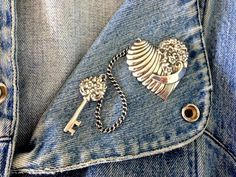 Repousse Sterling Heart and Key - Truart Sterling Silver 2 inch Floral Heart and Key Connected by Silver Chain Pin/Brooch by MagicalUniverse on Etsy https://www.etsy.com/listing/201666939/repousse-sterling-heart-and-key-truart