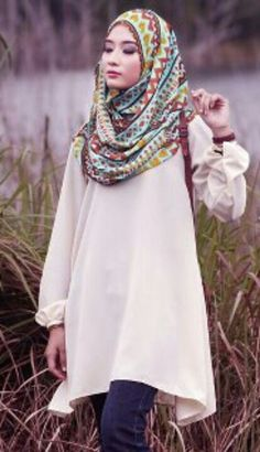 Attention-grabbing, colorful scarf (hijab) paired with understated, over-sized shirt and jeans