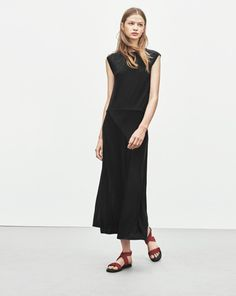 2851cb0f9e03b Sleeveless dress in tencel jersey with zip at centre back. Lined bias cut skirt  in Half calf length. A sophisticated dress that combines a feminine ...