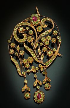 Art Nouveau Jewelry Pale Green Demantoid Garnets, Ruby and Rose Gold Brooch/Pendant. Made in Moscow between 1908 and 1917.