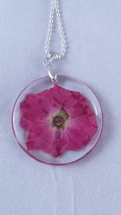 Hey, I found this really awesome Etsy listing at https://www.etsy.com/uk/listing/492398621/resin-dried-flower-pendants-pink