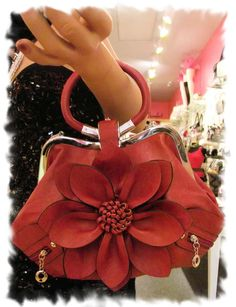 Flower Handbag available @ Allie Cat Boutique in NY! Fun accessory boutique just opened in Newburgh! You have to go take a look! Owner is really nice too! Refreshing! Visit and like their page at https://www.facebook.com/pages/Allie-Cat-Boutique-NY/247005858654483