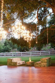 Lovely setting for a wedding or party...the chandeliers are so awesome and I love the hay bale couches..
