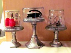 Mini Dessert Stands: Needed some small dessert stands?Can't find any at reasonable price. So... I found these candlesticks at a thrift store for $1 each, small wooden circles from Hobby Lobby $1 each, and $1 Dollar Tree vases for the lids. 1. Start by glueing the wood to the top of each candlestick... 2. Give them all 2 coats of spray paint... 3. Flip over the vases from The Dollar Tree that serve as lids. These were the perfect addition to my table!