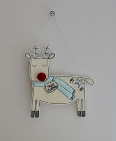 dreaming reindeer is happily waiting to pull Santa's sleigh. Reindeer is created using wool felt, silver glitter cloth, cotton cloth and free hand machine emb. Christmas Fair Ideas, Christmas Craft Projects, Handmade Christmas Decorations, Felt Decorations, Christmas Sewing, Christmas Embroidery, Christmas Makes, Christmas Inspiration, Christmas Art
