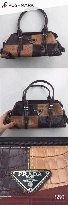 Used very few times Prada look alike handbag Used only two or three times. A few pulls on the threads inside. Very nice bag. other Bags Mini Bags