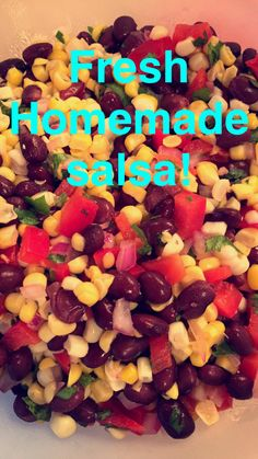 Toss together 2 cups fresh corn kernels, 1/2 cup diced red onion, 1 cup diced red bell pepper, 1/2 cup cilantro, juice from one fresh lime, 1 15 oz box organic black beans drained and rinsed, 1-2 diced jalapeños, and salt.