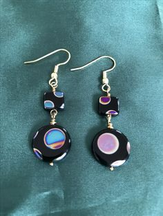 Black glass, with iridescence painted onto them in circular form. These earrings shimmer with movement; Fish Hook, Bead Earrings, Black Glass, Handcrafted Jewelry, Iridescent, Glass Beads, Gold, Style, Products
