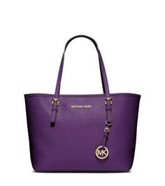MICHAEL KORS Get a handle on a tried-and-true favorite—our Jet Set tote will stay in your style rotation forever. This streamlined piece can carry all you need for a day out and about—whether you're headed to the beach or the office—but is stylish enough to complement your chicest evening looks. Transitioning your look from day to night has never been easier.