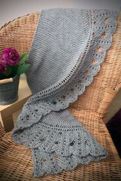 Free Knitting Pattern for Dominika Shawl - Crescent shaped shawl with a garter stitch body and cross stitch lace edge. It can be knit with any weight yarn. Designed by Ardilanak. Available in English and Spanish