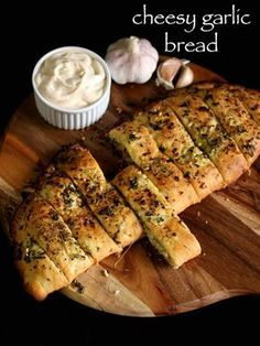 garlic bread recipe, cheesy garlic bread, garlic cheese bread with step by step photo/video. homemade domino's recipe, ideal as starter with pizza recipe