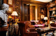 Alidad: panelled Londond study-library is a combination of leather furniture, objects d'arts, antique fabrics and paint effects.