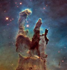 "The Eagle Nebula : the famous ""Pillars of Creation"" and the nebula's mutli-colored glow of gas clouds and dark cosmic dust"