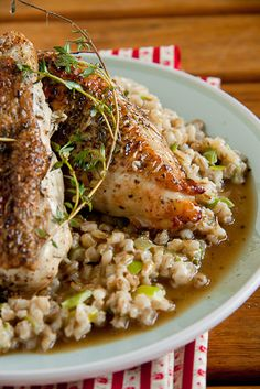 Roast Chicken with Barley Risotto. Dunno about the risotto but love the way the chicken is roasted with the stock, sounds like it would come out really tender and juicy.