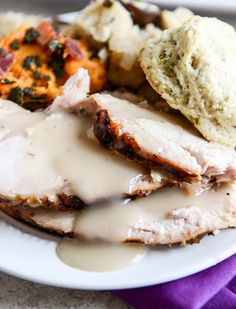 Applewood smoked turkey is prepped with a maple bourbon brine and served with a cider bourbon gravy! I howsweeteats.com