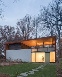 The Dahlonega Residence is articulated as a portal to the landscape; the main level is clad in acid-etched stucco and transparent glass, providing a layered, tectonic contrast to the voided space above.  #Architecture: David Jameson Architect | See more projects at: http://www.HandD.com/DavidJameson