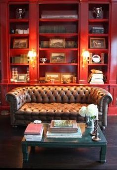 Red library - bookcase - shelves - built-ins - sconce light