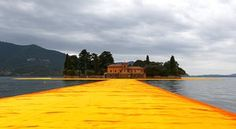 Christo and Jeanne-Claude's installation of 100,000 square metres of shimmering yellow fabric floating on Lake Iseo in northern Italy