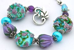 GASP! LOVE, LOVE, LOVE this!!! Aqua Purple Flowers Bracelet Lampwork Tulips by shalayneoriginals, $89.00