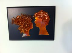 Copper Silhouettes on Plaque Board. All of my copper products are individually made, ensuring that each one is unique in its own way. The copper that I use is 28 gauge, and it is heated to bring out the natural beautiful color variations and originality in each sheet. This male and female profile have 3-d hair. The hair was cut from 28 gauge copper coils, then hand coiled to give it the desired curly effect. Each hair strand is then drilled and heated, then attached to the head portion…