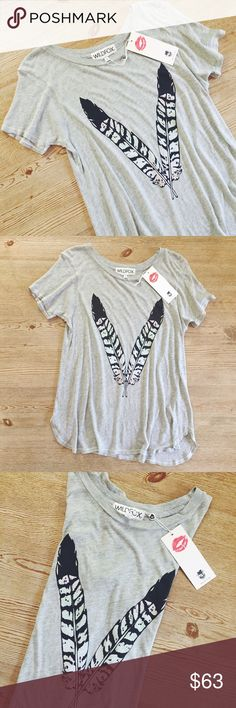 Wildfox Feather T-shirt Gorgeous t-shirt from Wildfox, color is gray with feathers, it's not a tight t-shirt, it's a flowy style; size is Medium. NWT  ✅% authentic with tags attached!    I. A M. A. S U G G E S T E D. U S E R ❕5% OFF purchases of 2 or more items❕       Shipping the day of or next day                    C L O S E T. R U L E S                   •no trading                    •smoke free home Wildfox Tops Tees - Short Sleeve