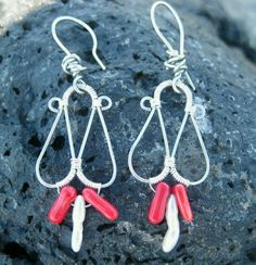 Serpent's Hoard earrings. Made with red coral, sterling silver, and freshwater pearls. Check it out at tidalfluxx.storenvy.com