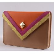 brown and orange envelope clutch with a golden button in the middle