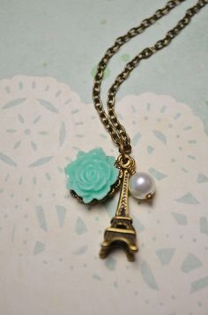 Paris inspired antique bronze necklace w/ Eiffel Tower, teal cabochon rose and white glass pearl.