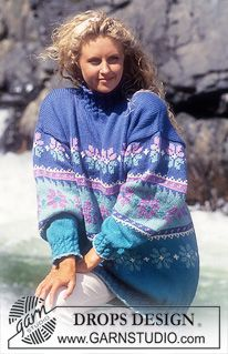 "Drops Sweater with snow flowers in ""Alaska"" Short or long version. ~ DROPS Design"