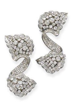 A PAIR OF ART DECO DIAMOND CLIP BROOCHES. Each designed as a pavé-set diamond…