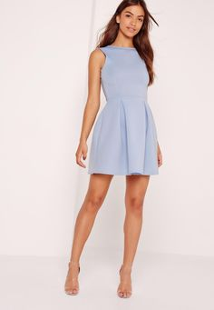 Get low! This fancy 50's style dress with a plunging low back looks heaven sent, and we put it straight to the top of our lust list! In a powder blue shade, skater style with low back detail, pair with strappy heeled sandals and a clutch fo...