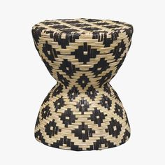 Our black and tan hourglass woven rattan stool from Palecek doubles as an accent table with bold modern style. Features an Aztec inspired pattern.