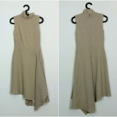 """Minimalist Chic Merino Wool Dress Obsessed w this tan architectural dress with matching scarf. So elegant. Channel Claire Underwood or Olivia Pope. Power babe dress. By Unger. Size 6 Made in NYC. 100% Merino wool. Lined. Back zip. Asymmetric cut and design. Shown on 5'8"""" size s. Great condition overall. Very mild pilling, few tiny imperfections in wool. Interior lining has mild yellowing. Matching scarf has a stain, pretty pale in color and approx 1.5"""" so not very noticeable.  Tag Zara…"""