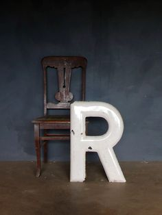 Vintage heavy porcelain letter R sign in white.