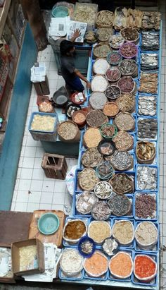 Dried fish seller at Petojo market - the wet market in Jakarta Indonesia