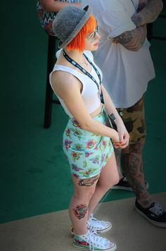 Hayley watching New Found Glory play. It looks like she has a new tattoo on her leg.