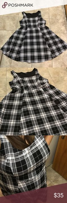 Torrid Black & White Checkered Dress Super cute black & white checkered dress from Torrid! Pullover style dress, skirt swings a bit, empire waist. Size 1, excellent condition - no stains, tears or damage!     🐶All items come from a pet friendly home!🐶 torrid Dresses Midi