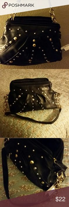 NWT Black Purse with gold metal detail Small/Medium 27 inch strap, 12 inch long, 3 inch width, height 7 inches, faux leather with gold metal design Bags Shoulder Bags