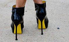 So this won't link me to a DIY page but it still inspires me. I am totally buying black pumps and painting the bottoms yellow. Batman heels!