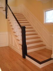 Red oak staircase with black painted handrails. Dark Walnut aniline dye applied to nosing. Contact us for this look.