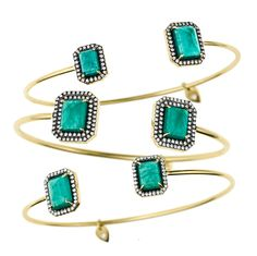 Travel solo or layer up with yellow gold bangles framed with stunning emeralds and white diamonds. via @The Jewellery Editor  @JEMMA WYNNE  jewelry is now available at Timeless.