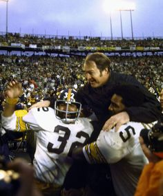 1975 Pittsburgh Steelers running back Franco Harris and defensive tackle Mean Joe Greene carry their head coach, Chuck Noll, off the field after defeating the Minnesota Vikings Baltimore Colts, Nfl Dallas Cowboys, Indianapolis Colts, Pittsburgh Steelers, Nfl Championships, Championship Game, Giants Football, Football Helmets, Chuck Noll