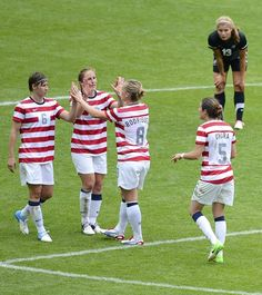 The USA celebrates defeating New Zealand in their women's quarter final soccer match at the London 2012 Olympic Games at St James' Park in Newcastle