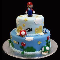 "Super Mario: fondant design around each tier with handmade fondant ""Mario"" figurine on top."