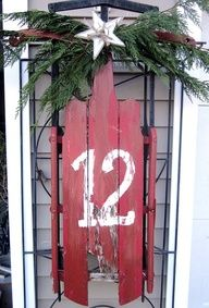 decorated old wooden sled with house number on it and pine swag with a star at the top. - Google Search