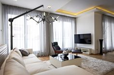The LUMOS chandelier stand can easily adjust to fit the needs of any room.