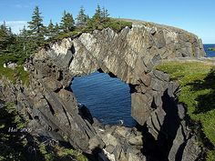 Located on the Spurwink Trail, East Coast Trail to the south of St. John's, Newfoundland, is an incredible rock formation known as the Berry Head Sea Arch near Port Kirwan. Newfoundland And Labrador, Newfoundland Canada, Places Around The World, Around The Worlds, East Coast Canada, Sea To Shining Sea, Destinations, A Whole New World, Adventure Is Out There