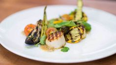 Dress up grilled scallops, zucchini, yellow summer squash and eggplant with an easy charred tomato vinaigrette.