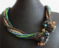 Necklace | Sabine Lippert. 'Wrapped sparkle'  could use the Silkworm technique and jewels for a nice alternative