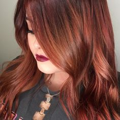 Cherry cola —a classic auburn warm red hair color by Aveda Artist Andrea.  Formula: base: 10g 6N 30 grams IB 6 grams pure R 4 grams pure V 20 vol pulled through   Midshaft to ends: 40g 7N with 4g light n/n 4g light o/r 4g light y/o 10 vol